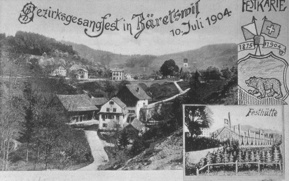 Festkarte zum Bezirksgesangfest in Bäretswil von 1904 mit Blick auf die Stalden Mühle, das alten Lettenschulhaus, den damals neuen Bahnhof mit Brücke und die Kirche.